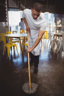 waiter-mopping-floor-in-cafe-DTJGV5P