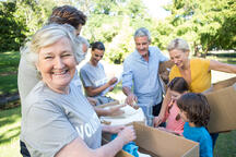 Happy volunteer family separating donations stuffs on a sunny day-2